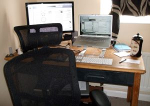 desktop computer, laptop and a chair